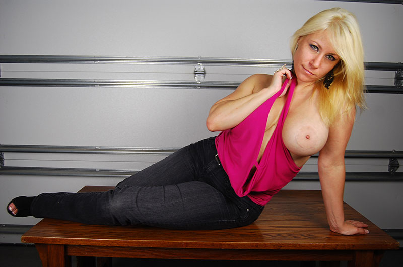 Dominant busty FemDom handjob model Lady Bella featured on HandDomination.