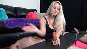 FemDom handjob video performed by cock abusing blonde Angie Lewis on 2 restrained cum filled cocks featured on HandDomination.