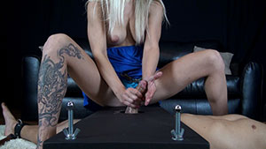 FemDom handjob video performed by Caroline De Jaie on a restrained cum filled cock featured on HandDomination.