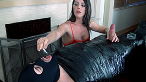 FemDom handjob video performed by Charlotte Davis on a restrained cum filled cock featured on HandDomination.