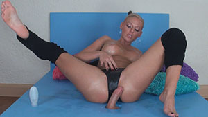 Gloryhole handjob video performed by Courtney Cameron on a restrained cum filled cock featured on HandDomination.