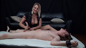 Evil Step mom FemDom handjob video performed by Dallas Diamondz on a restrained cum filled cock featured on HandDomination.