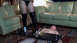FemDom handjob video performed by beautiful sadistic hispanic model Eve Rosario on a restrained cum filled big white cock featured on HandDomination.