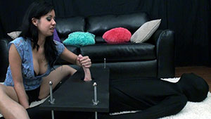 FemDom handjob video performed by D-cup Asian beauty Kimmy Lee on a restrained cum filled cock featured on HandDomination.