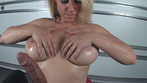 POV handjob video performed by busty MILF Lady Bella on a large white cum filled cock featured on HandDomination.