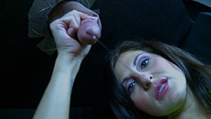 Gloryhole handjob video performed by Lola Lynn on a restrained cum filled cock featured on HandDomination.
