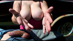 Public outdoor handjob video performed by Mandy Collins on a restrained cum filled cock featured on HandDomination.