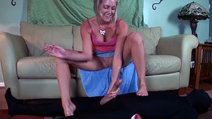 FemDom handjob video that showcases her exquisite feet performed by sadistic blonde Taylor Raz on a cum filled white cock featured on HandDomination.