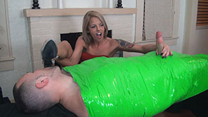 FemDom handjob video performed by Violet Skye on a restrained cum filled cock featured on HandDomination.